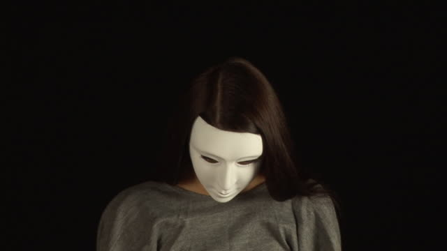 Masked Girl - with White Mask, HD & PAL Stock video clip footage of a masked girl slowly lifting her head - Tripod mask disguise stock videos & royalty-free footage