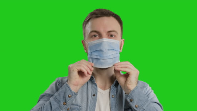 masked man protects himself from epidemic. young male wearing medical mask - face mask stock videos & royalty-free footage