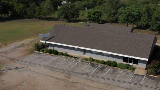 Masonry building with a shingle roof, Bryan, Texas, USA