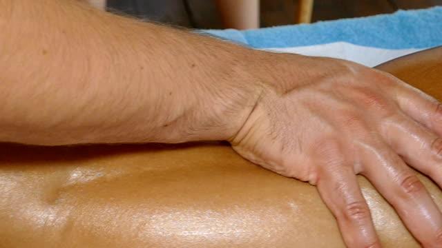massage female leg, slow motion - china drug video stock e b–roll
