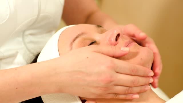 Massage of face at beauty treatment salon video
