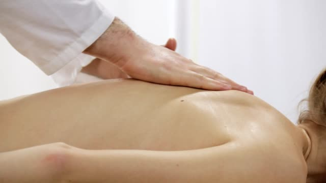 Massage slowly stroking the back of the patient video