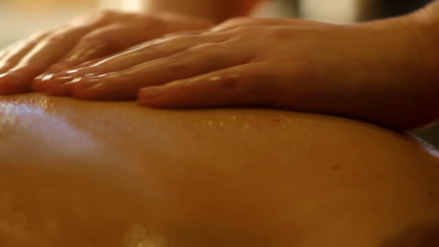 Massage treatment performed by masseuse video