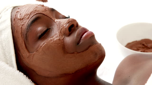 masseuse applying product on her client face - spa facial stock videos & royalty-free footage