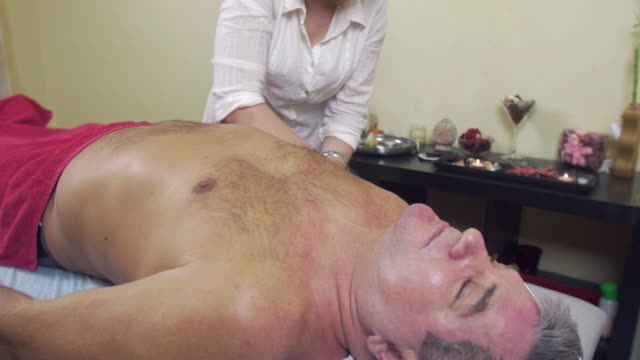 Masseuse hands make professional massage of right hand to adult fat man Masseuse hands make professional massage of right hand to adult fat man. Therapeutic. Healthcare. Medium shot pinching stock videos & royalty-free footage