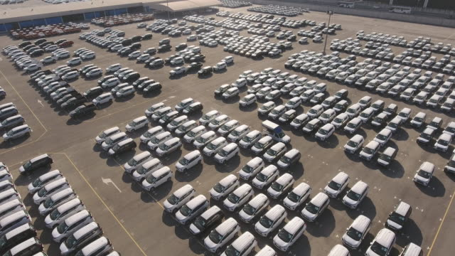 Massive Dockside Yard of New Cars for Import/Export with Morning Sunrise, Aerial View Massive Dockside Yard of New Cars for Import/Export with Morning Sunrise, Aerial View car rental stock videos & royalty-free footage