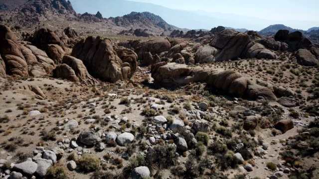 Massive Rock Formations and Undergrowth in Desert video