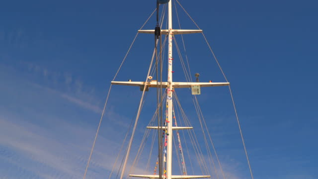 Mast sailing yacht in the background of the sky with clouds video