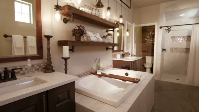 Master Bathroom Lower From Sink lowering shot in a modern master bathroom with a rustic industrial style bathroom stock videos & royalty-free footage
