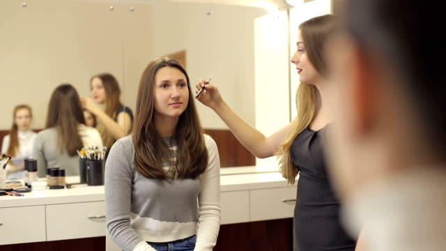 Master class for make-up artists. Young woman make-up artist tells a make-up technique for a group of girls. Master class for make-up artists. beautician stock videos & royalty-free footage