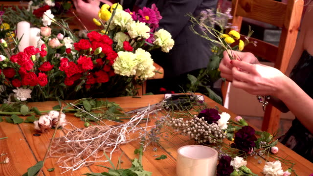 Master class of a florist making flower ring. video