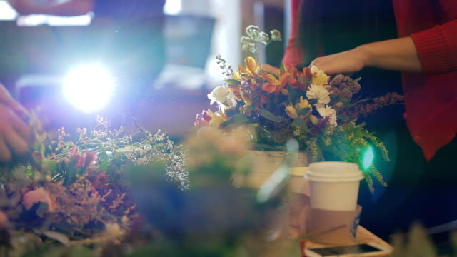 Master florist, a group of specialists working on building design to the grand opening. flowers, bouquets, boutonnieres, greens video