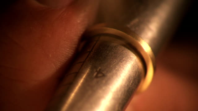 Master goldsmith hammers ring into shape video