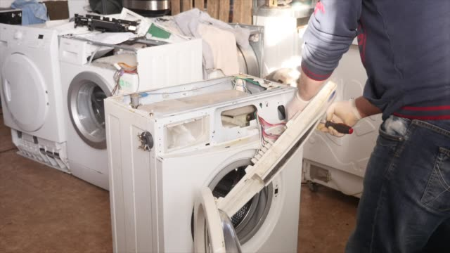 Master on Repair Washing Machine Master on Repair Washing Machine. Master on repair washing machine appliance stock videos & royalty-free footage