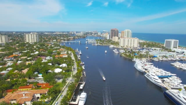 Master shot of boats and condos Ft. lauderdale Aerial 4k Fort Lauderdale' s Venice of America and it's magnificent inland waterways. The famous Millionaire's Row which stretches from Tarpon Bend all the way out to the Intracoastal Waterway south stock videos & royalty-free footage
