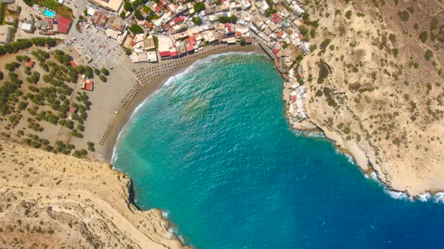 Matala, Crete, Greece. Aerial drone shot. Elafonisi lagoon. Crete, Greece. Aerial drone shot. 4K 30fps ProRes greek islands stock videos & royalty-free footage