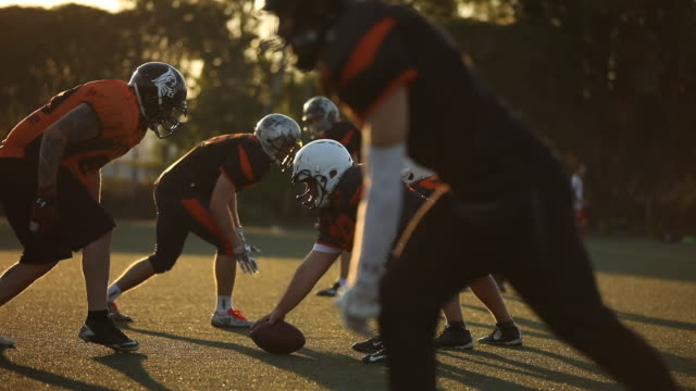 NFL match outdoors Group of men, American football players on rough training outdoors. football stock videos & royalty-free footage