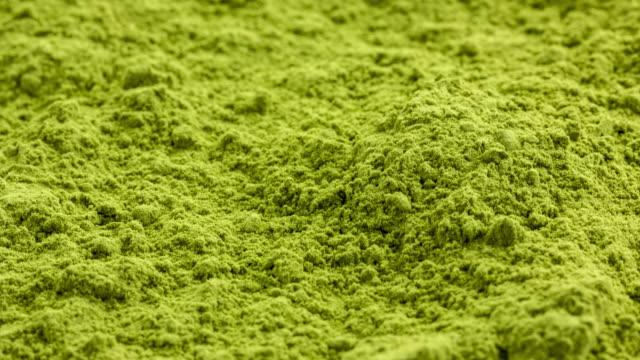 Matcha tea ground on white background