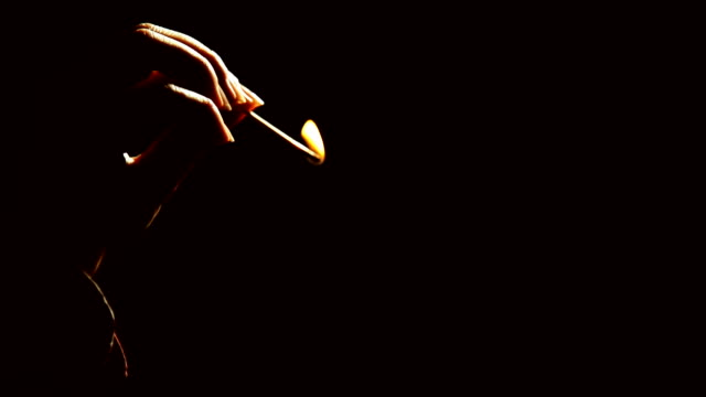 Matches. Hands light matches video