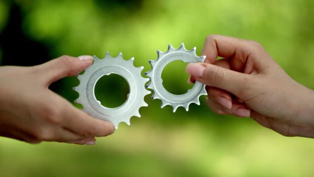 Matching cog gears. Business teamwork video