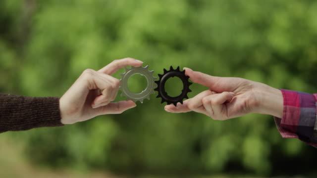 Matching cog gears. Teamwork metaphor video