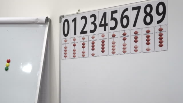 Math abacuses board - numbers and counting sticks video