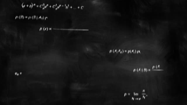 math physics formulas on chalkboard flying camera video