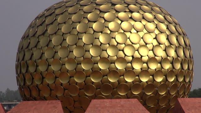 Matrimandir - modern  architecture Golden Temple in Auroville for meditation, India video