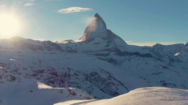 matterhorn mountain at sunset in winter. snowy swiss alps. switzerland. aerial view - пик стоковые видео и кадры b-roll