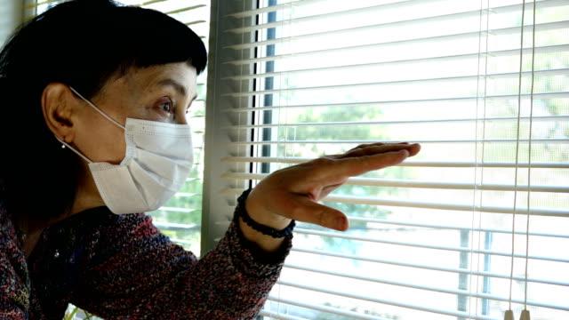 Mature adult brunette woman caucasian ethnicity, in medical mask.