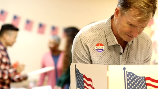 Mature adult man votes in USA election. video