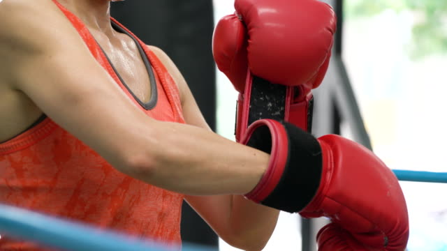 Mature adult woman training at boxing gym video