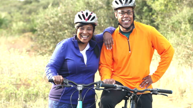 Mature African American couple biking together video