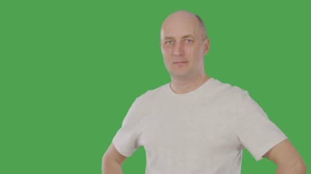 Mature agree man nodding head on keyed green screen. Alpha channel Mature agree man nodding head. Smiling man in casual t-shirt looking at camera. Alphachannel, keyed green screen arms akimbo stock videos & royalty-free footage