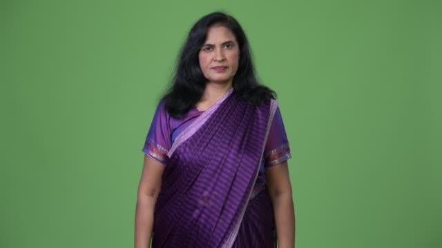 mature beautiful indian woman wearing sari traditional clothes - sari filmów i materiałów b-roll