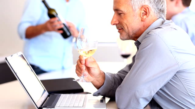 Mature business man drinking white wine video