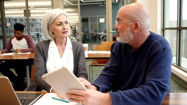 Mature Caucasian couple take college course together