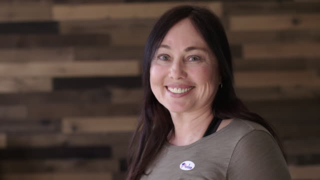 MCU Mature Caucasian woman puts on I Voted sticker and smiles video