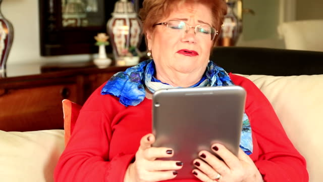 Mature caucasian woman using digital tablet video
