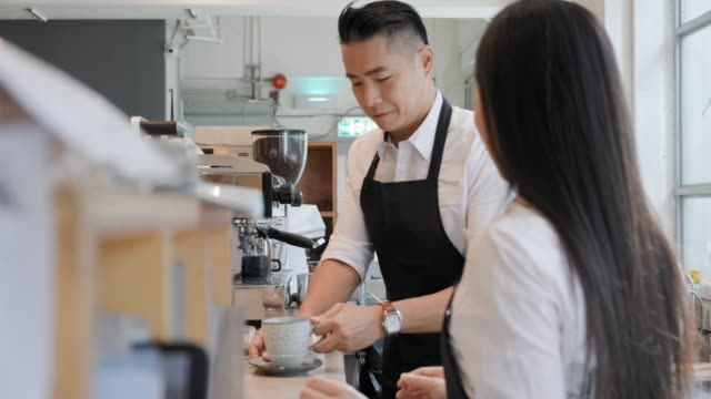 Mature Chinese Barista Making Coffee in Hong Kong Cafe video