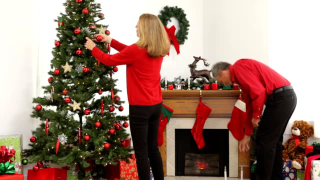 Mature couple decorating for Christmas video