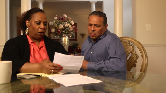 Mature Couple Discuss Financial Issues - WS