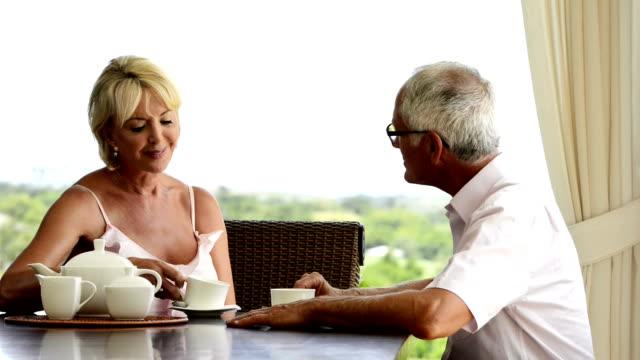 Mature couple has tea video