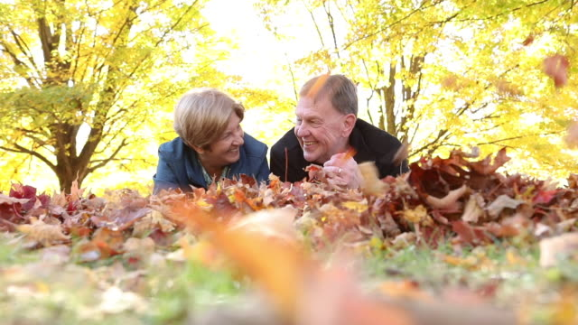 Mature Couple in Fall Leaves