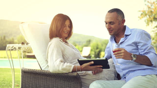 Mature couple planning future on laptop video