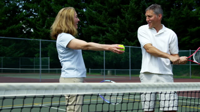 Mature couple prepare to play tennis HD 1080p: Mature couple prepare to play tennis 50 59 years stock videos & royalty-free footage