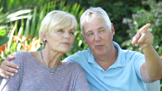 Mature Couple Relaxing Sitting Outside Together video