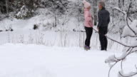 istock Mature couple take pics in snowy forest setting 1196853336