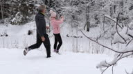 istock Mature couple take pics in snowy forest setting 1196858885