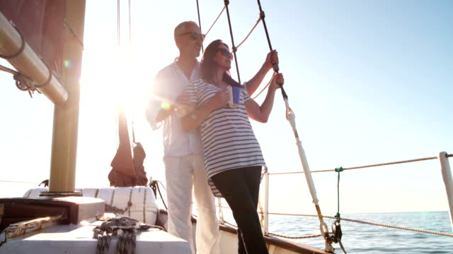 Mature couple traveling on a yacht with early morning coffee video